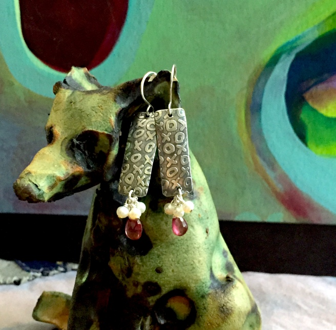 Wolf-dog by Shannon Bueker. Earrings are etched sterling with pearls and garnets